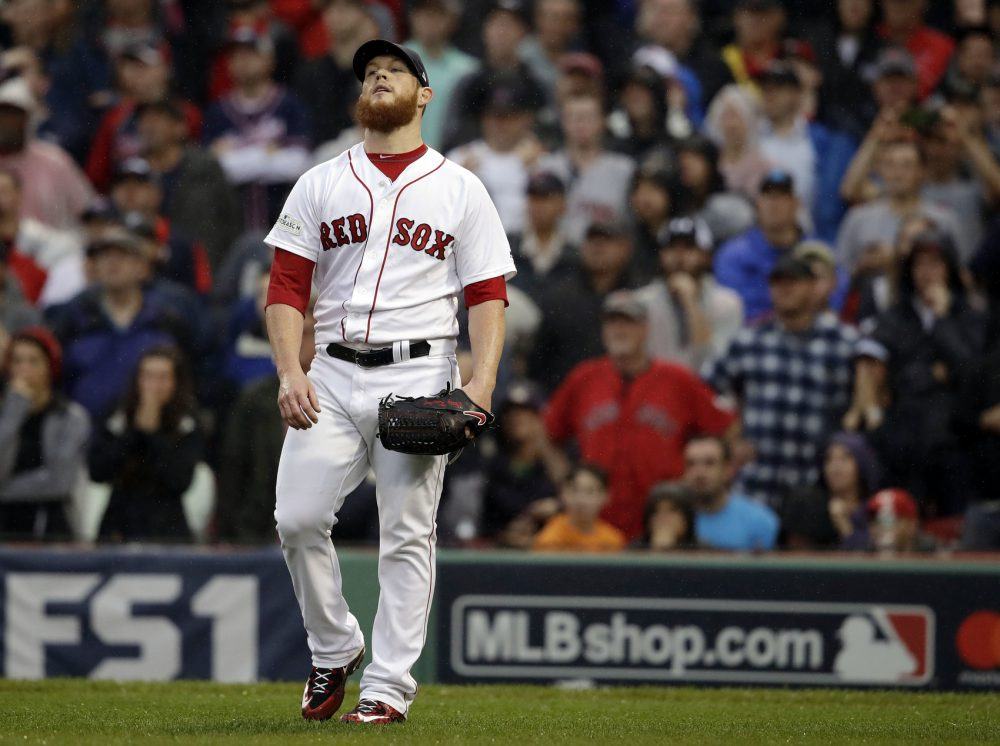 Boston Red Sox relief pitcher Craig Kimbrel reacts after giving up an RBI single to Houston Astros designated hitter Carlos Beltran during the ninth inning in Game 4 of baseball's American League Division Series, Monday, Oct. 9, 2017, in Boston. (AP Photo/Charles Krupa)