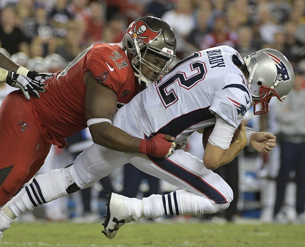 Tampa Bay Buccaneers defensive tackle Gerald McCoy (93) sacks New England Patriots quarterback Tom Brady (12) during the second quarter of an NFL football game Thursday, Oct. 5, 2017, in Tampa, Fla. (AP Photo/Phelan Ebenhack)