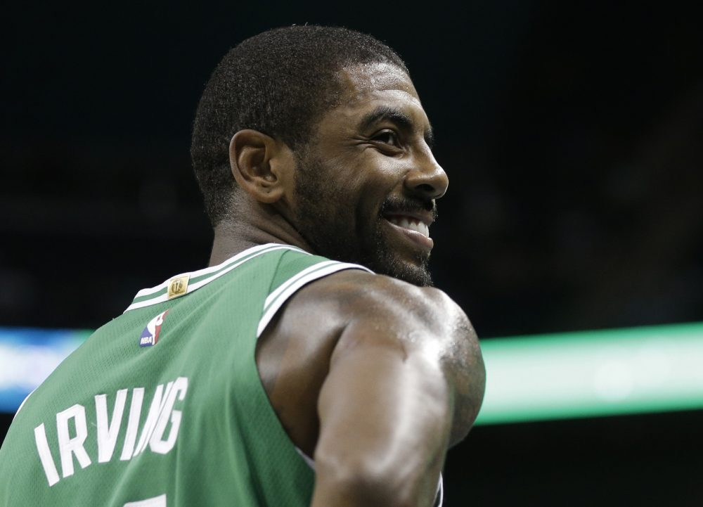 Boston Celtics' Kyrie Irving (11) smiles in the first half of a preseason NBA basketball game against the Charlotte Hornets in Charlotte, N.C., Wednesday, Oct. 11, 2017. (AP Photo/Chuck Burton)