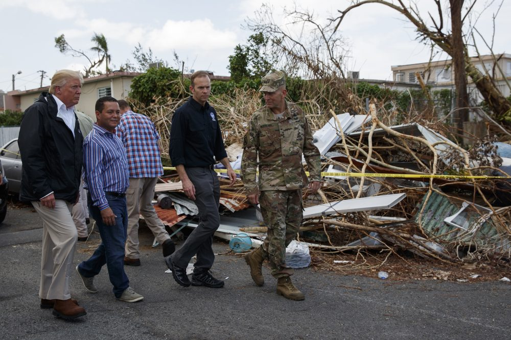 President Donald Trump tours a neighborhood impacted by Hurricane Maria on Tuesday in Guaynabo, Puerto Rico. (Evan Vucci/AP)