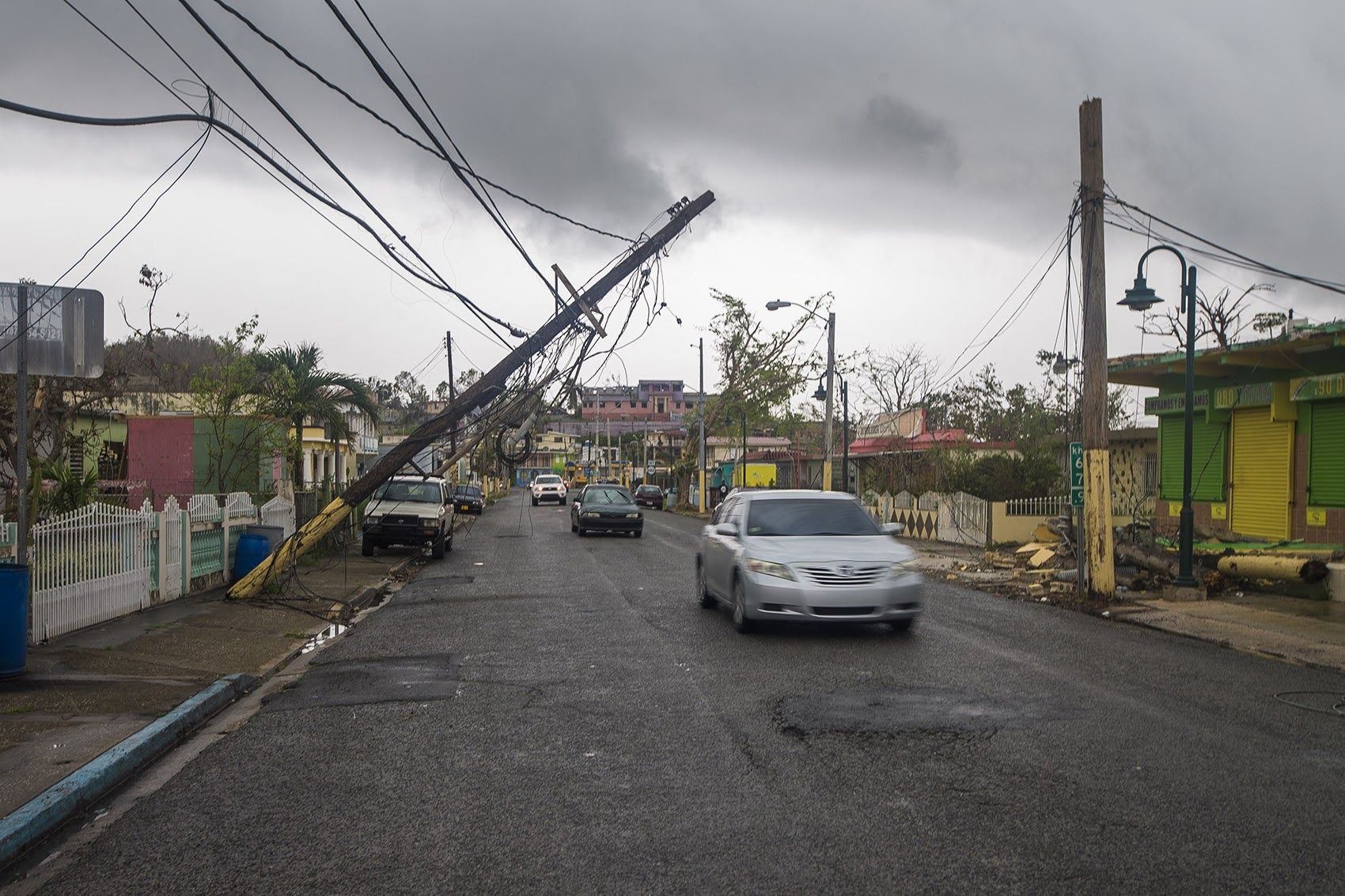 Downed powerlines along a main street in Barcenoleta, in early October (Jesse Costa/WBUR)