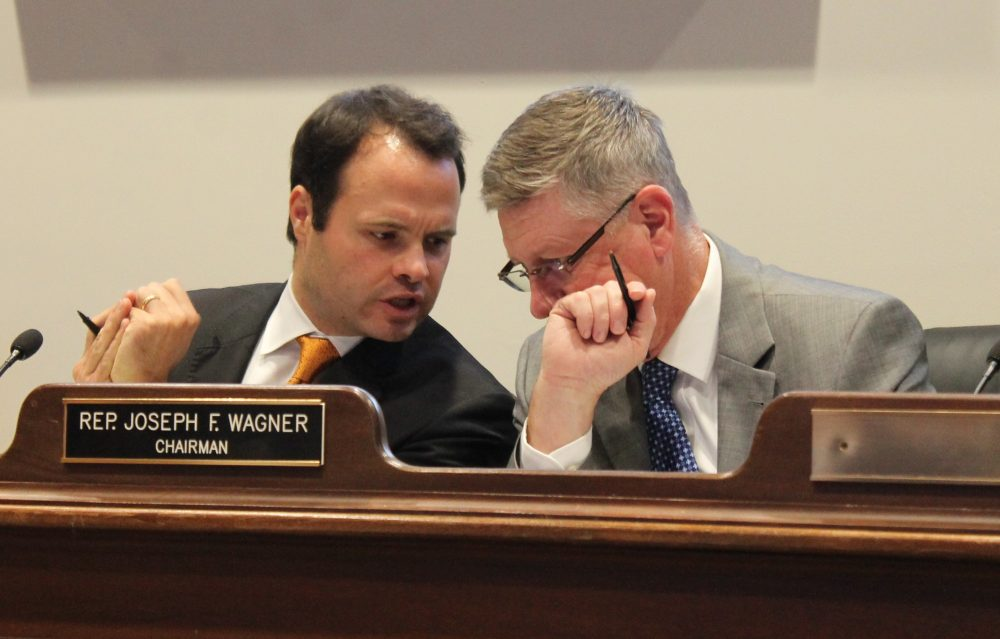Sen. Eric Lesser and Rep. Joseph Wagner (right), chairmen of the Economic Development and Emerging Technologies Committee, consulted during Tuesday's hearing. (Photo: Sam Doran/SHNS)