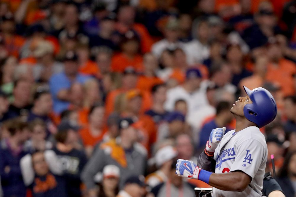 During Game 5 of the World Series, Yasiel Puig (front) hit a home run into the bleachers of Minute Maid Park in Houston. The ball was quickly thrown back onto the field. (Christian Petersen/Getty Images)