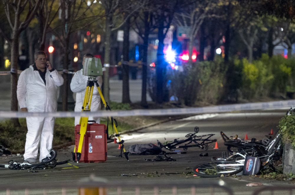 Bicycles and debris lay on a bike path at the crime scene near the World Trade Center memorial on Tuesday. (Craig Ruttle/AP)