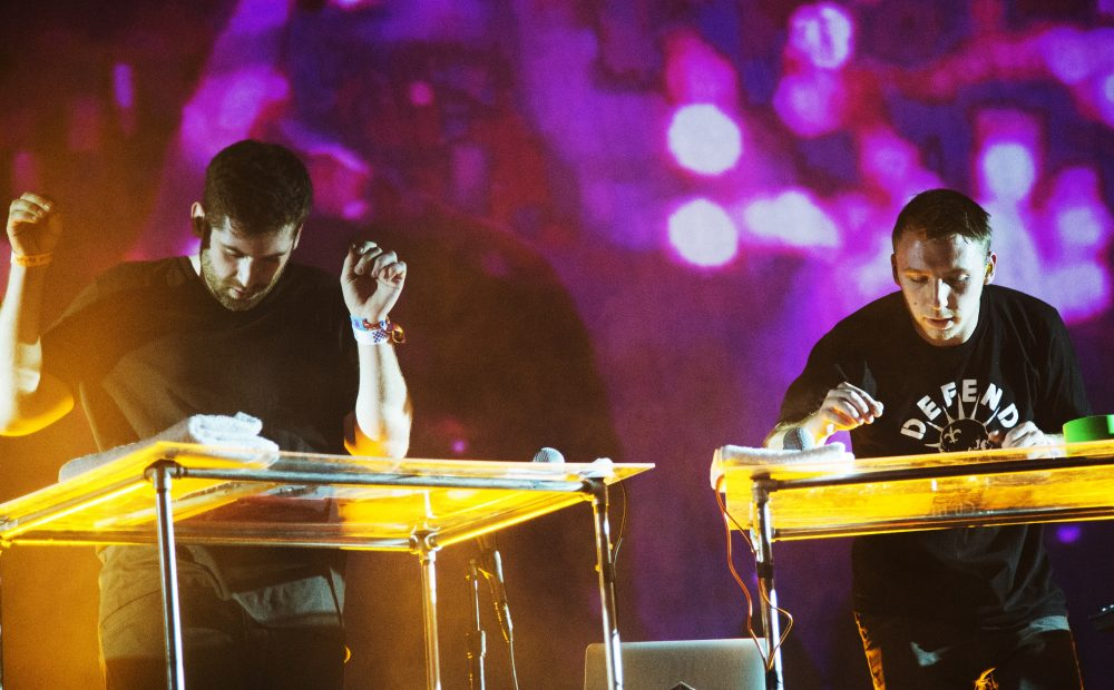 Harrison Mills and Clayton Knight of the American electronic music duo Odesza perform on day three of the Coachella Music Festival in Indio, Calif., in April 2015. (Robyn Beck/AFP/Getty Images)