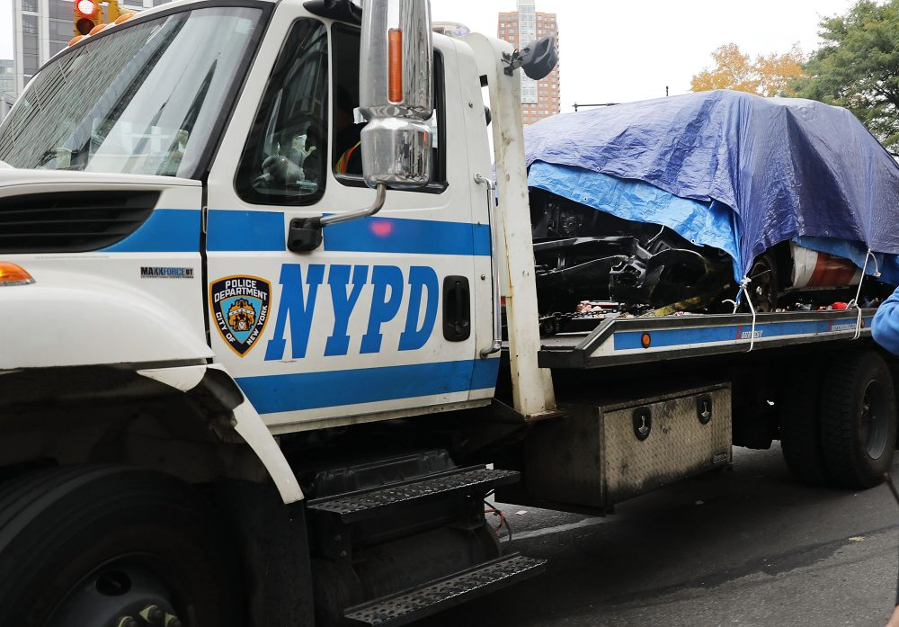 The crashed vehicle used in what is being described as a terrorist attack is moved away from the scene in lower Manhattan the day after the event on Nov. 1, 2017 in New York City. (Spencer Platt/Getty Images)
