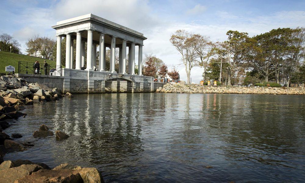 Plymouth Rock lies at the water's edge in this monument at Pilgrim Memorial State Park in Plymouth, Mass. (Robin Lubbock/WBUR)