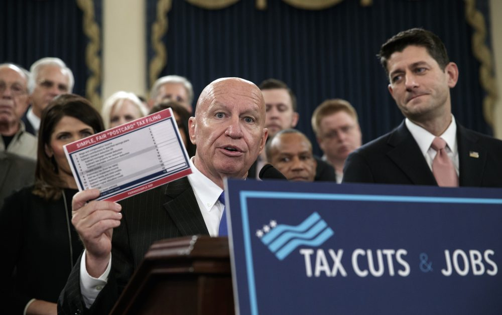 """House Ways and Means Committee Chairman Kevin Brady, R-Texas, joined by Speaker of the House Paul Ryan, R-Wis., right, holds a proposed """"postcard tax filing form"""" as they unveil the GOP's far-reaching tax overhaul, the first major revamp of the tax system in three decades, on Capitol Hill in Washington, Thursday, Nov. 2, 2017. (J. Scott Applewhite/AP)"""
