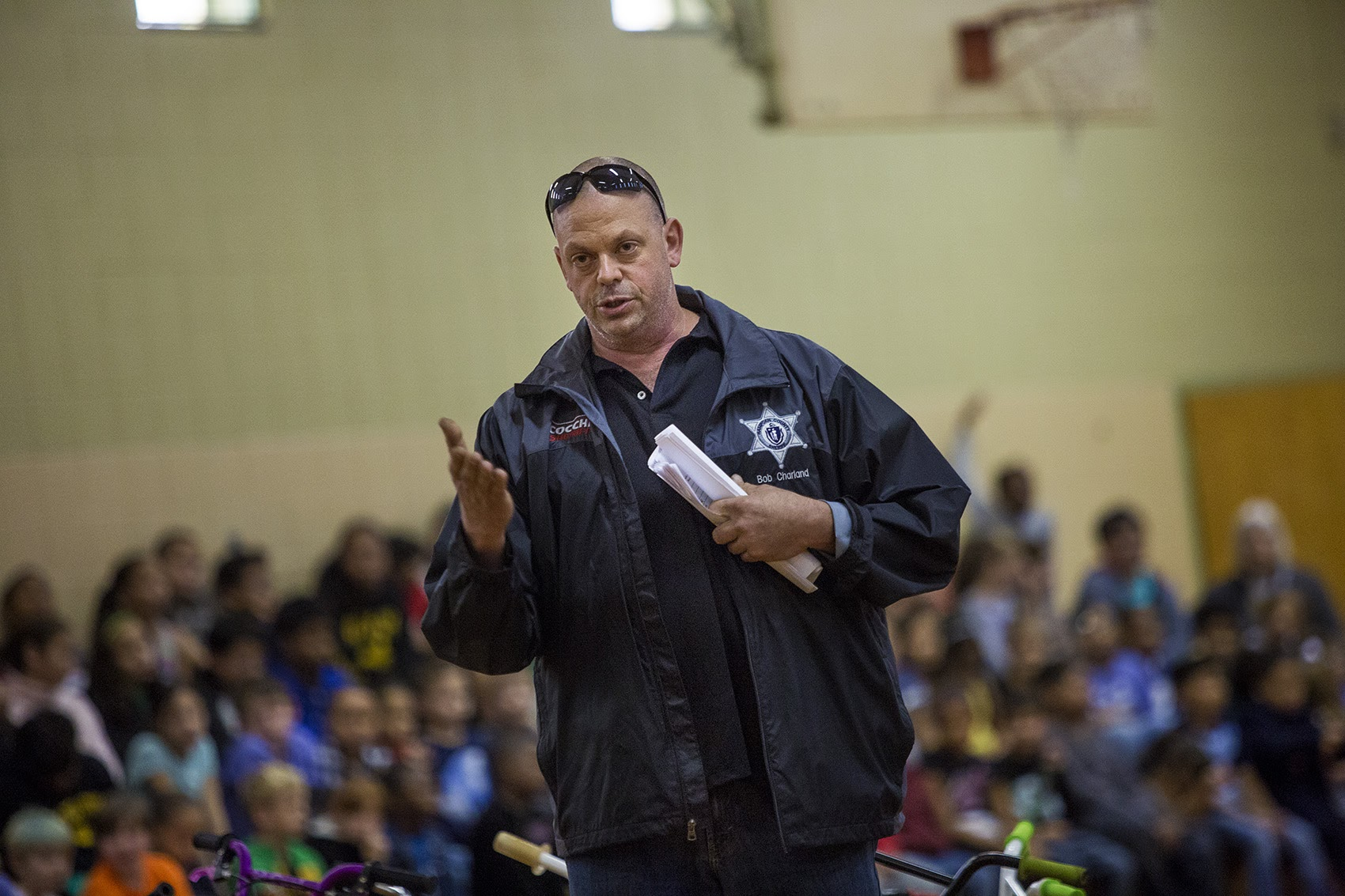 Bob Charland speaks to students at the Stefanik School in Chicopee about bicycle safety. (Jesse Costa/WBUR)