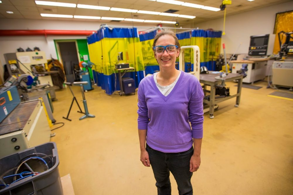 Dr. Daniela Faas, director of design and fabrication operations, in one of the fabrication rooms at Olin College. (Jesse Costa/WBUR)