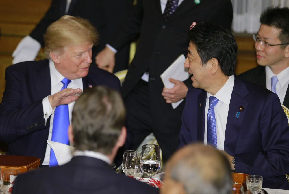 President Trump talks with Japanese Prime Minister Shinzo Abe at the opening of a welcome dinner hosted by Abe at Akasaka Palace in Tokyo on Nov. 6, 2017. (Shizuo Kambayashi/AFP/Getty Images)