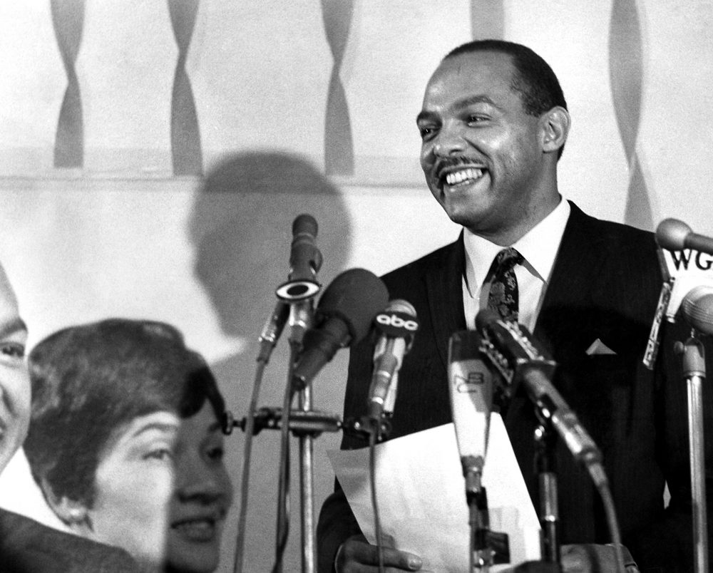 Carl B. Stokes makes a victory statement at his campaign headquarters in Cleveland, Oct. 3, 1967, after almost complete returns indicated he had won the Democratic nomination for mayor of Cleveland by a margin of more than 12,000 over the incumbent mayor, Ralph S. Locher. Stokes' wife, Shirley, is on the left. (AP Photo)
