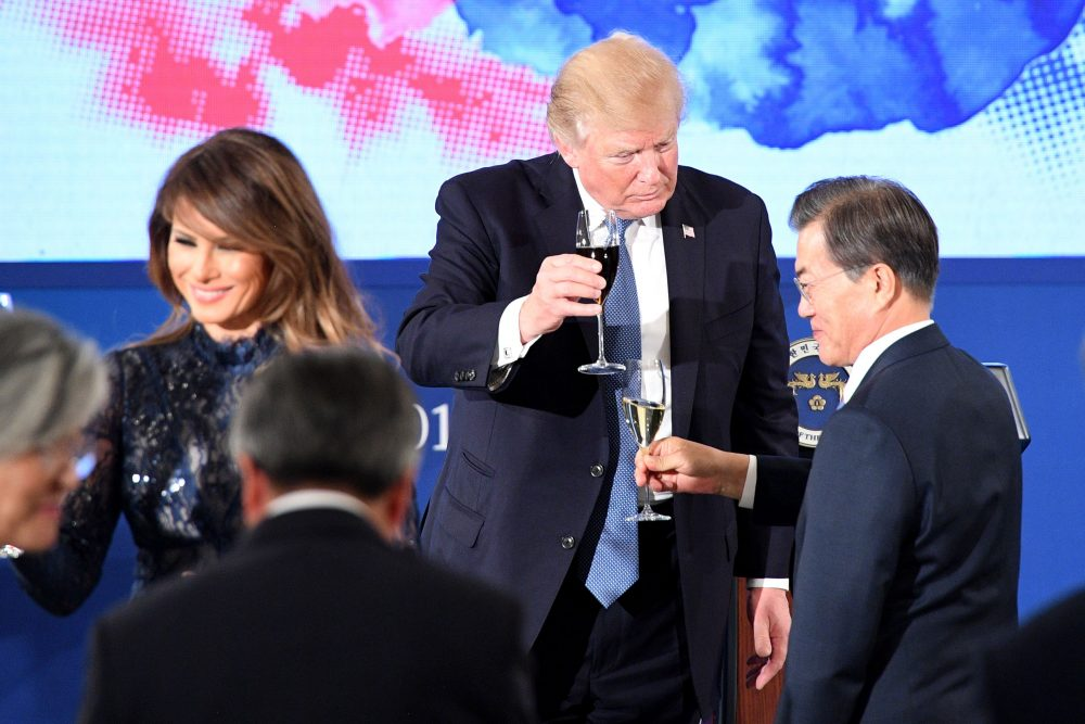 President Trump toasts South Korea's President Moon Jae-In (right) near first lady Melania Trump during a state dinner at the presidential Blue House in Seoul on Nov. 7, 2017. (Jim Watson/AFP/Getty Images)