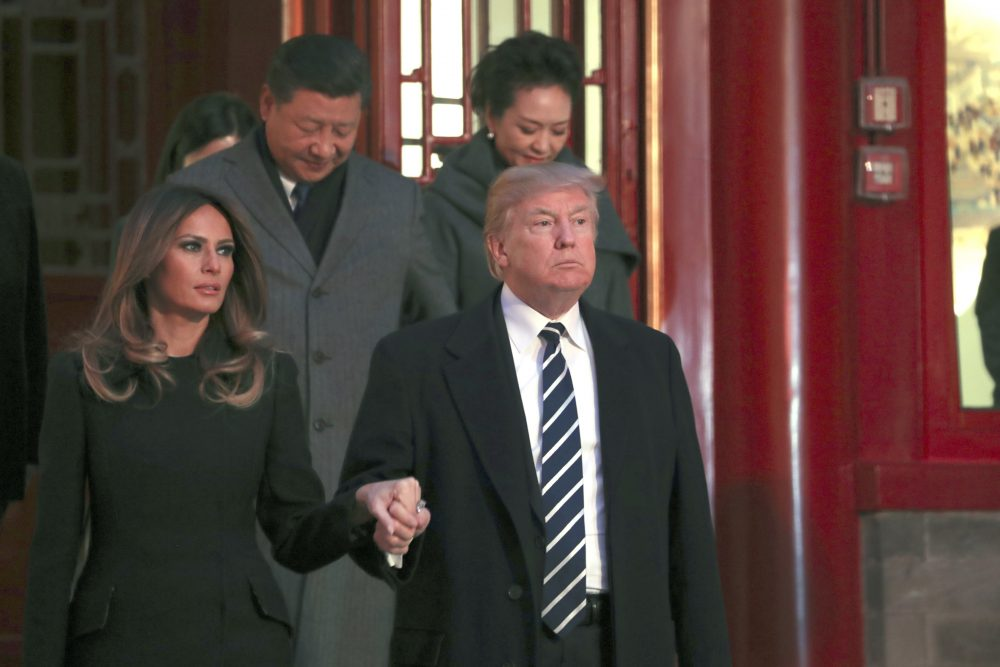 President Trump and first lady Melania Trump arrive with Chinese President Xi Jinping, left back, and Xi's wife Peng Liyuan, right back, to watch an opera performance at the Forbidden City, Wednesday, Nov. 8, 2017, in Beijing. (Andrew Harnik/AP)