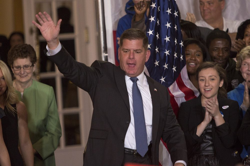 Boston Mayor Marty Walsh waves to the crowd as he arrives on stage to deliver his victory speech. (Jesse Costa/WBUR)