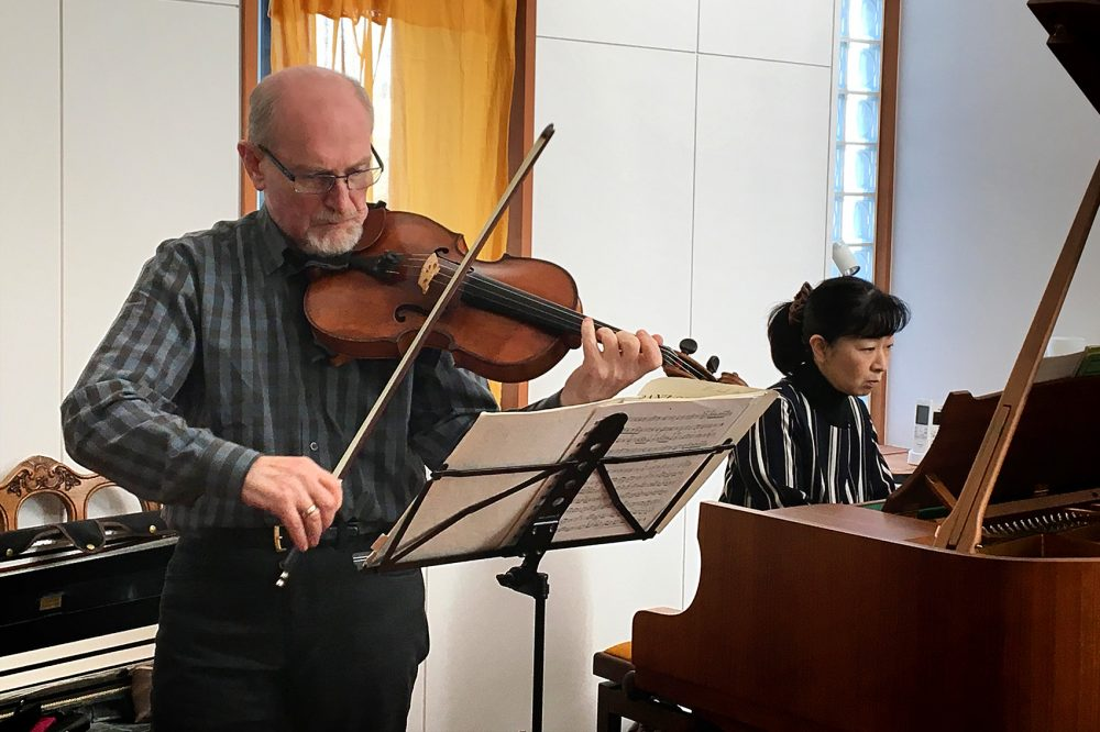 Boston Symphony Orchestra violist Michael Zaretsky and Japanese pianist Chikako Shibata rehearse ahead of their Monday concert in Ishinomaki. (Andrea Shea/WBUR)