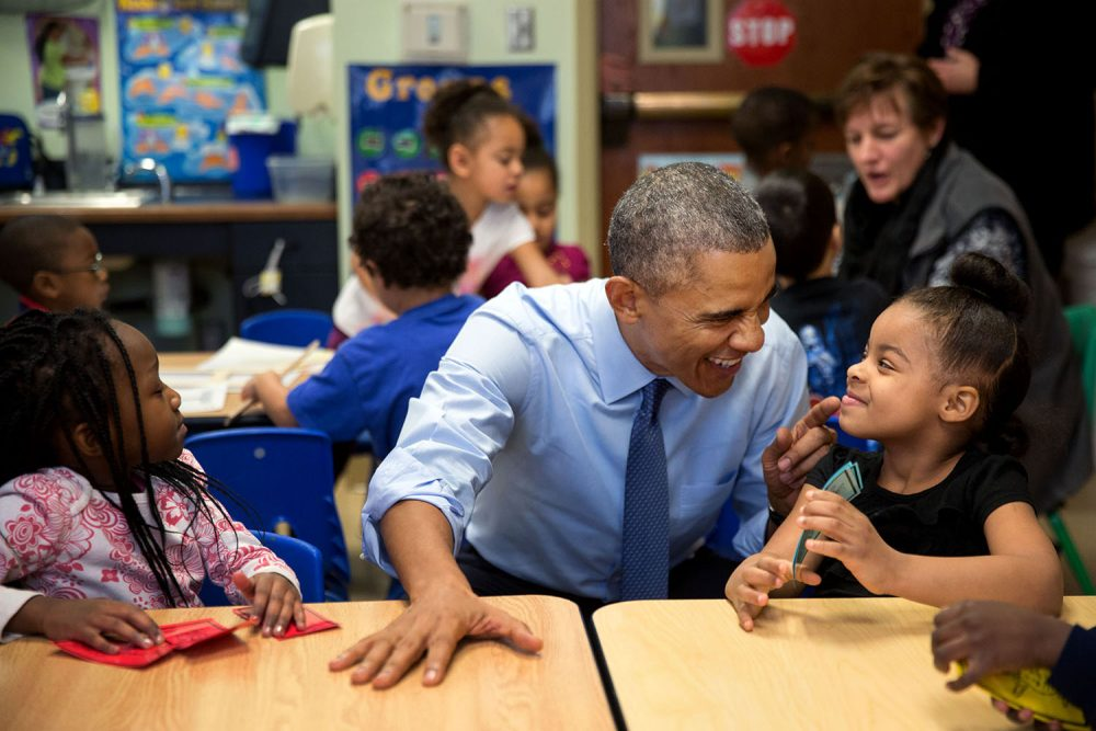 """""""While we were in Lawrence, Kan., we stopped at the Community Children's Center–one of the nation's oldest Head Start providers. The president sat next to Akira Cooper, right, and reacted to something she said to him."""" (Official White House Photo by Pete Souza)"""