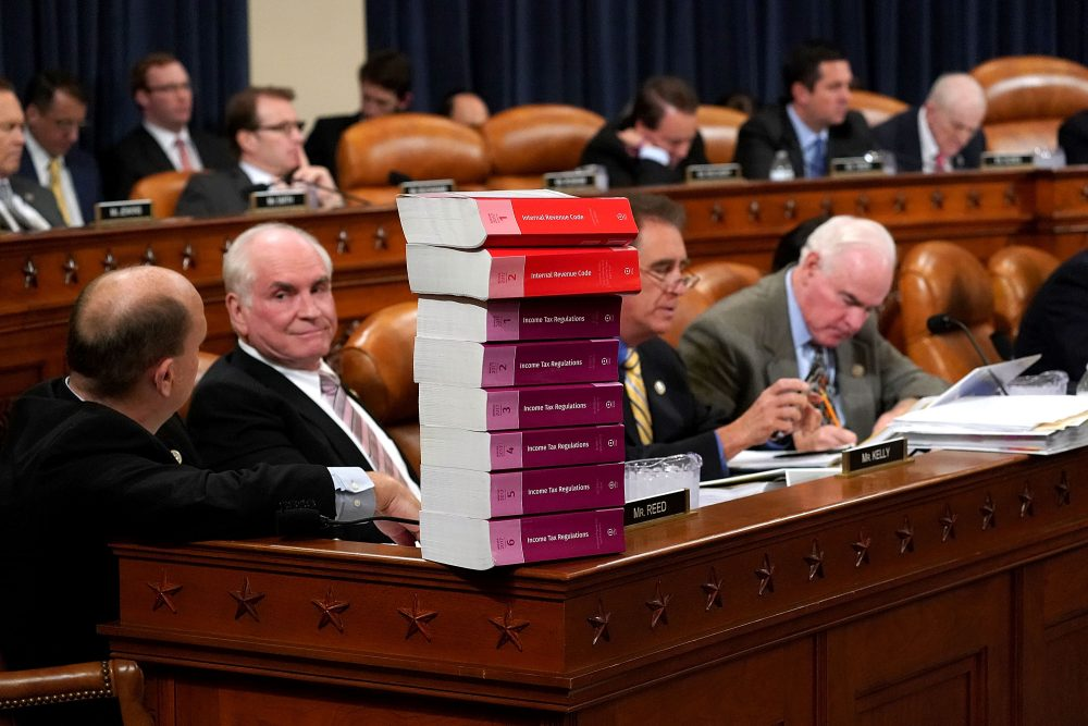 House Ways and Means Committee member Rep. Tom Reed (R-N.Y.) keeps a stack of books that document the current federal tax code and related regulations on his desk during the first markup of the proposed GOP tax reform legislation in the Longworth House Office Building on Capitol Hill Nov. 6, 2017 in Washington, D.C. (Chip Somodevilla/Getty Images)