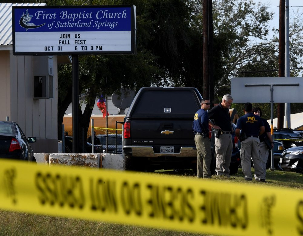FBI agents search for clues at the entrance to the First Baptist Church, after a mass shooting that killed 26 people in Sutherland Springs, Texas, on Nov. 6, 2017. (Mark Ralston/AFP/Getty Images)