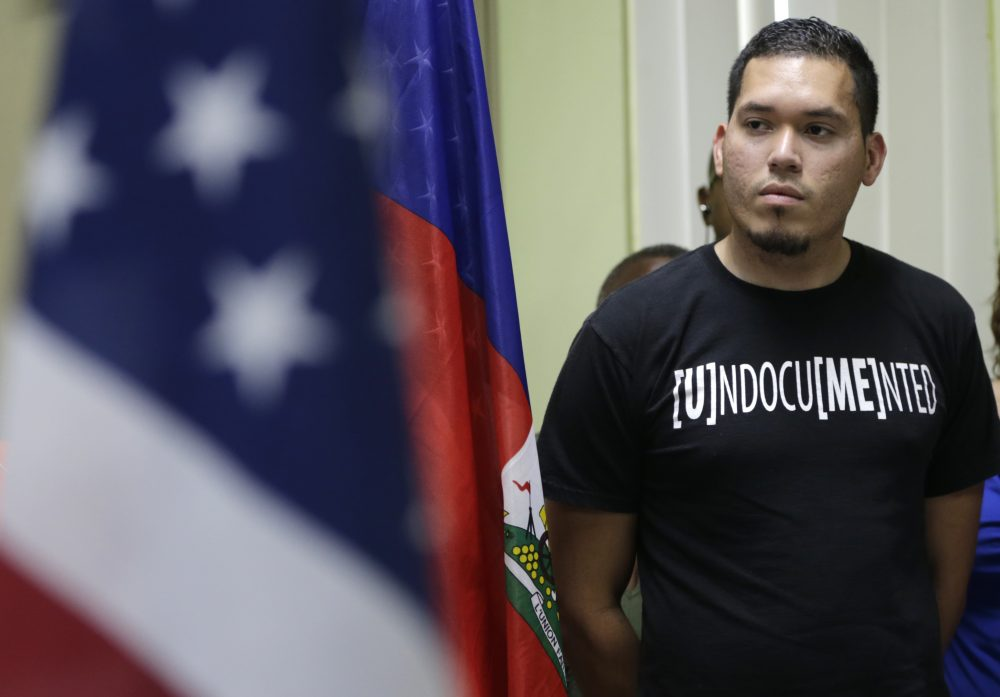 Julio Calderon, 28, an undocumented immigrant from Honduras, listens after speaking in favor of renewing Temporary Protected Status (TPS) for immigrants from Central America and Haiti now living in the United States, during a news conference Monday, Nov. 6, 2017, in Miami. The Department of Homeland Security is expected to rule soon on whether or not to renew the protected status. (Lynne Sladky/AP)