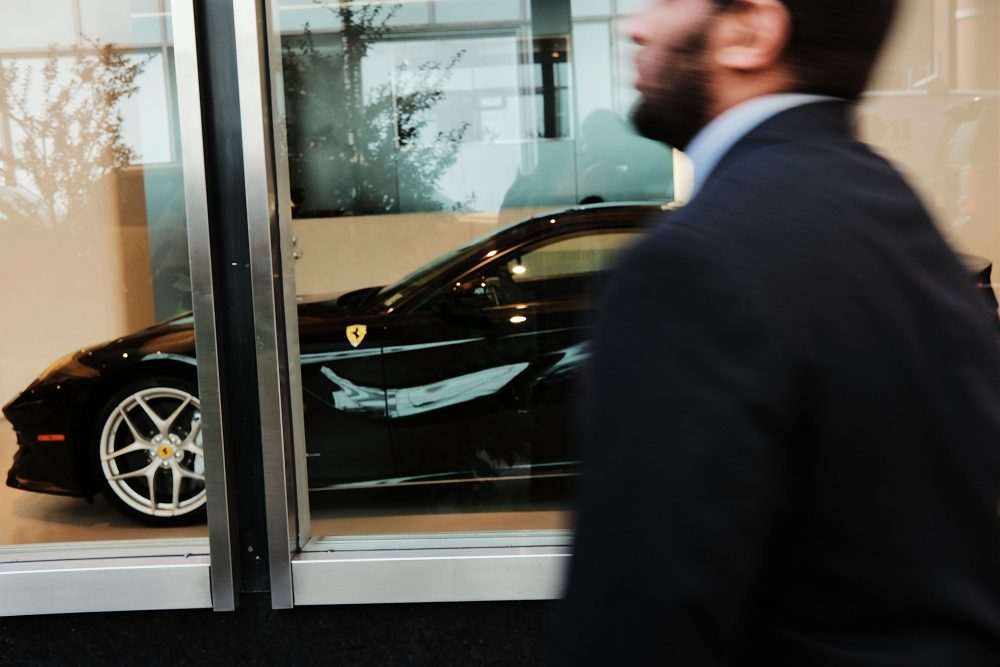 Ferrari automobiles are displayed in a Manhattan window on Sept. 28, 2017 in New York City. The Trump administration's tax overhaul plan quickly drew attention for the benefits it would give to wealthy Americans, including members of the Trump family. Among other things the plan calls for eliminating the federal estate tax, and for cutting the corporate tax rate from 35 to 20 percent.  (Spencer Platt/Getty Images)
