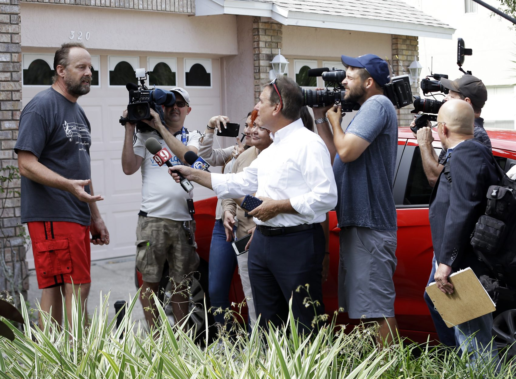 Eric Paddock, left, brother of Las Vegas gunman Stephen Paddock, speaks to members of the media outside his home, Monday, Oct. 2, 2017, in Orlando, Fla. (John Raoux/AP)