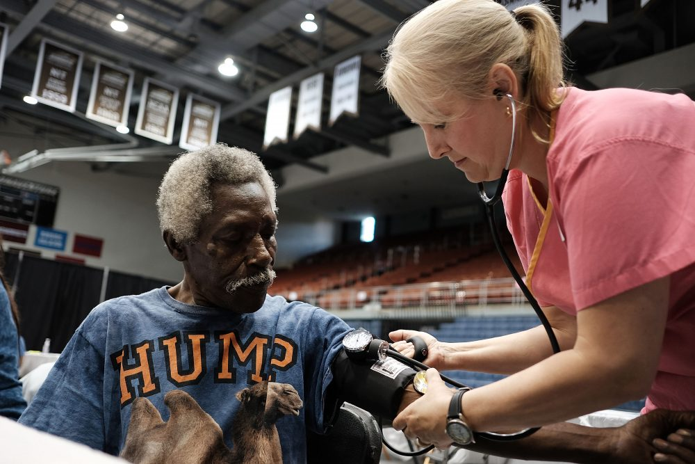 Thyleb Ramadhan has his blood pressure checked at the Remote Area Medical (RAM) mobile dental and medical clinic on June 10, 2017 in Olean, New York. (Spencer Platt/Getty Images)