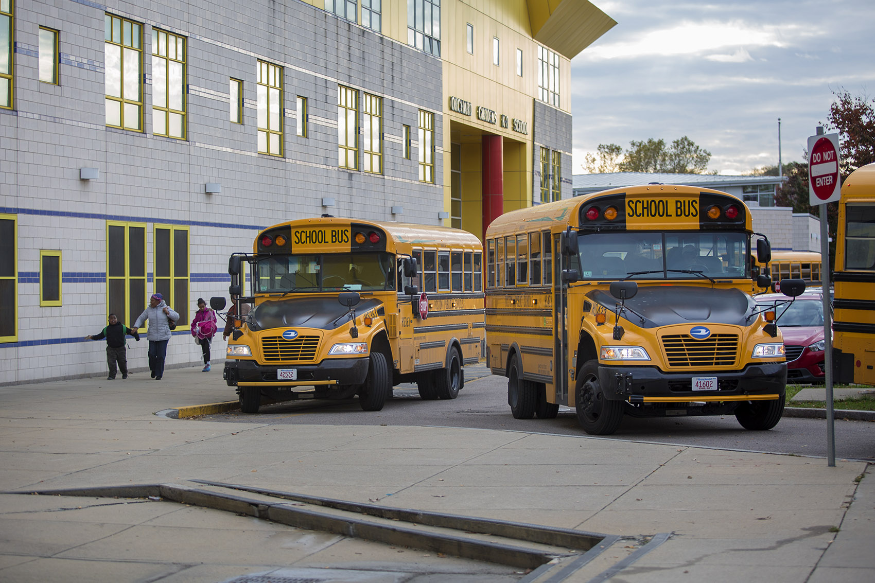 Buses idle as drivers wait for students to board outside the Orchard Gardens K-8 Pilot School. (Jesse Costa/WBUR)
