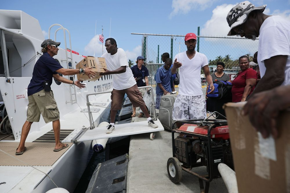 Crew and volunteers load the Queen Elizabeth IV ferry with supplies and passengers for St. Thomas more than a week after Hurricane Irma made landfall Sept. 17, 2017 in Christiansted, St. Croix, U.S. Virgin Islands. (Chip Somodevilla/Getty Images)