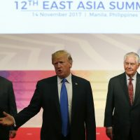 President Trump (center) gestures to the press as U.S. National Security Advisor H.R. McMaster (left) and U.S. Secretary of State Rex Tillerson look on after attending the 31st Association of Southeast Asian Nations (ASEAN) Summit in Manila on Nov. 14, 2017. (Bullit Marquez/AFP/Getty Images)