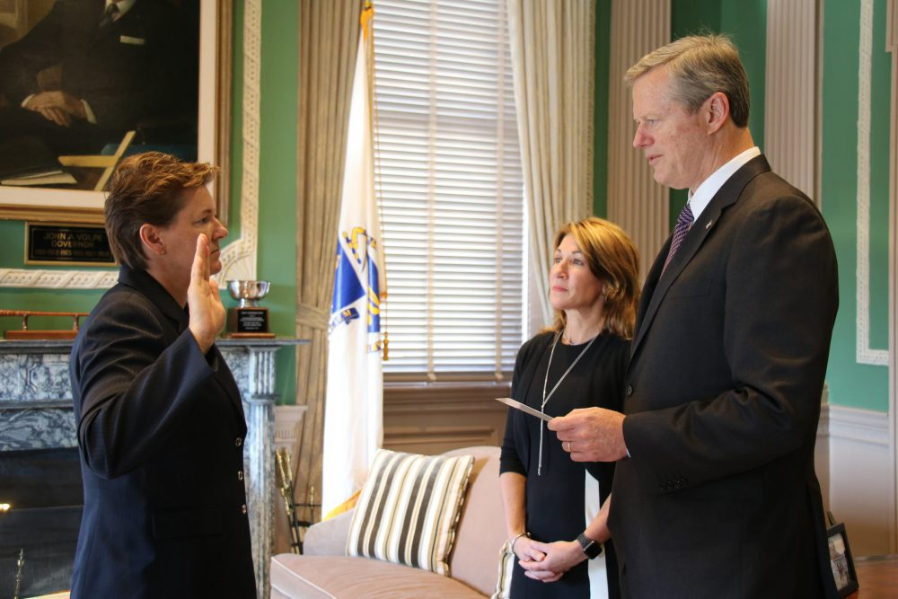 Gov. Charlie Baker, right, swears in Colonel Kerry Gilpin, left, with Lt. Gov. Karyn Polito. (Courtesy governor's office)