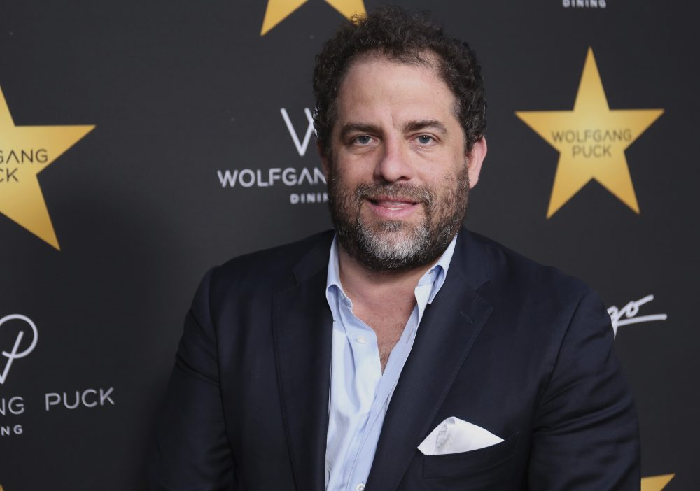 In this April 26, 2017 file photo, Brett Ratner arrives at the Wolfgang Puck's Post-Hollywood Walk of Fame Star Ceremony Celebration in Beverly Hills, Calif.  Hollywood's widening sexual harassment crisis ensnared another prominent film director when six women, Including actress Olivia Munn, accused Ratner of harassment or misconduct in a Los Angeles Times report, on Wednesday, Nov. 1. (Willy Sanjuan/Invision/AP)