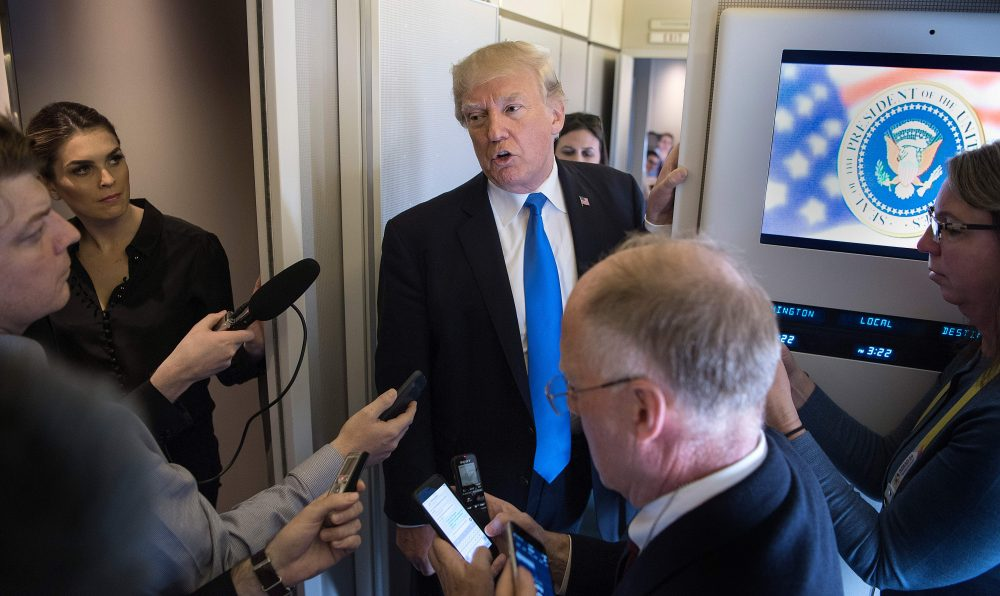 President Trump speaks to reporters aboard Air Force One while departing the Philippines on Nov. 14, 2017. (Jim Watson/AFP/Getty Images)