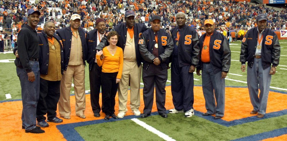 In 2006, the university recognized the 'Syracuse 8' for their stand against discrimination. Left to right: Art Monk, Ron Womack, Duane Walker, Alif Muhammad, Syracuse Chancellor Nancy Cantor, Clarence McGill, Dana Harrell, John Lobon, Greg Allen and Richard Bulls. (Kevin Rivoli/AP)
