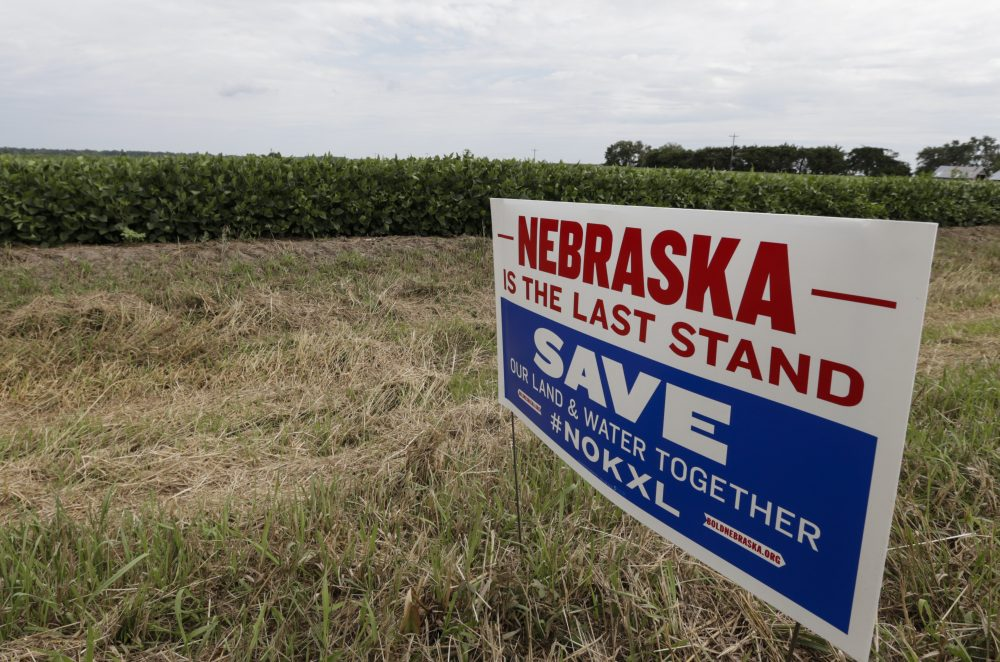 A roadside sign against the construction of the Keystone XL pipeline is seen where the proposed pipeline would go through the property of Jim Carlson, in Silver Creek, Neb. (Nati Harnik/AP)