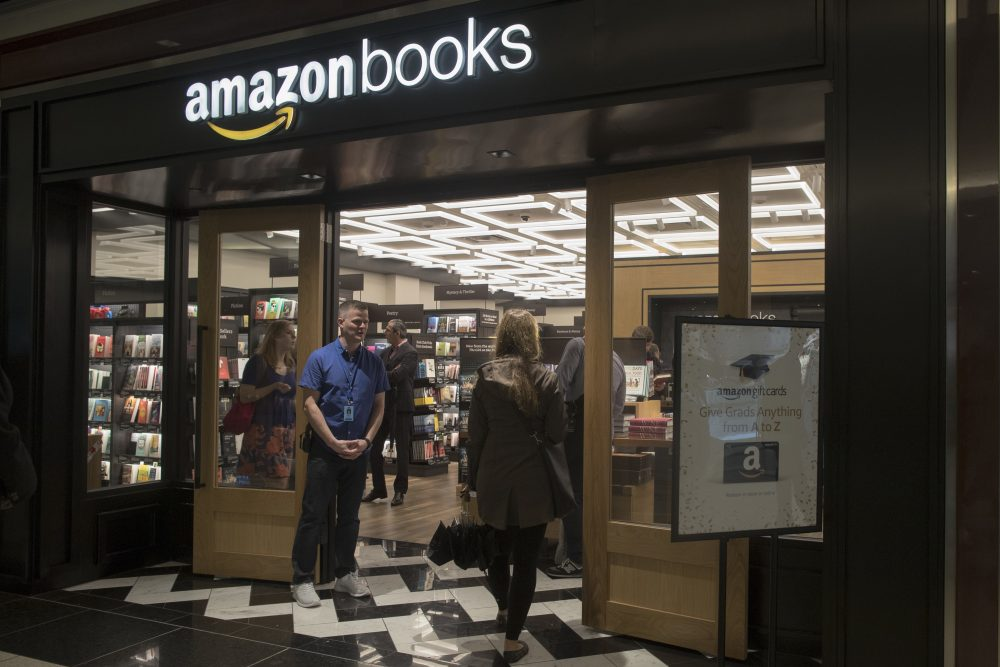 In this Thursday, May 25, 2017, photo, a woman is greeted by an Amazon Books store employee as she arrives at the store in the Time Warner Center at Columbus Circle, in New York. (Mary Altaffer/AP)
