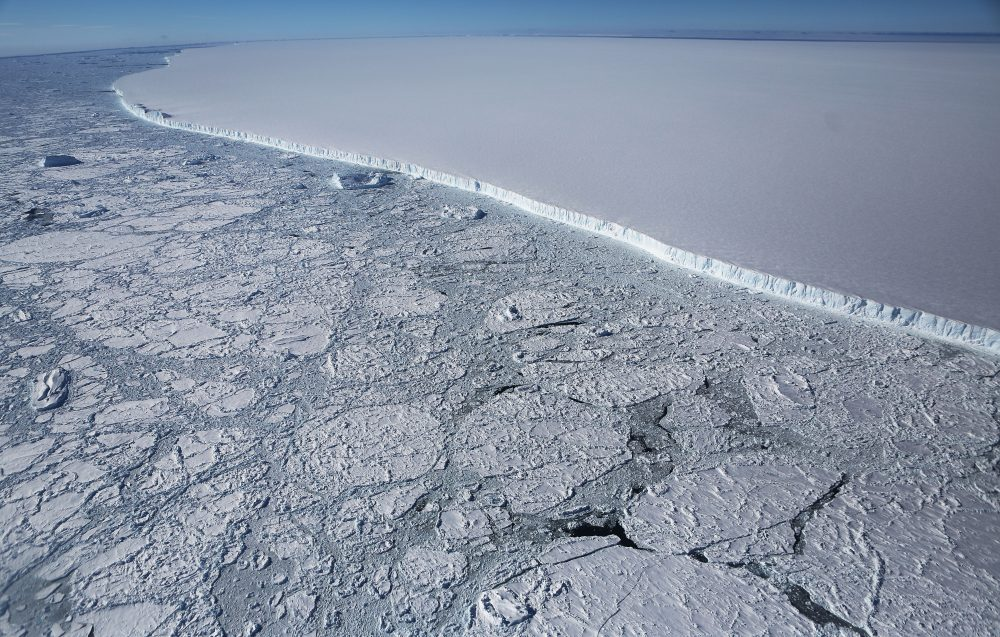 The western edge of the famed iceberg A-68 (TOP R), calved from the Larsen C ice shelf, is seen from NASA's Operation IceBridge research aircraft, near the coast of the Antarctic Peninsula region, on Oct. 31, 2017, above Antarctica. The massive iceberg was measured at approximately the size of Delaware when it first calved in July. NASA's Operation IceBridge has been studying how polar ice has evolved over the past nine years and is currently flying a set of nine-hour research flights over west Antarctica to monitor ice loss aboard a retrofitted 1966 Lockheed P-3 aircraft. (Mario Tama/Getty Images)
