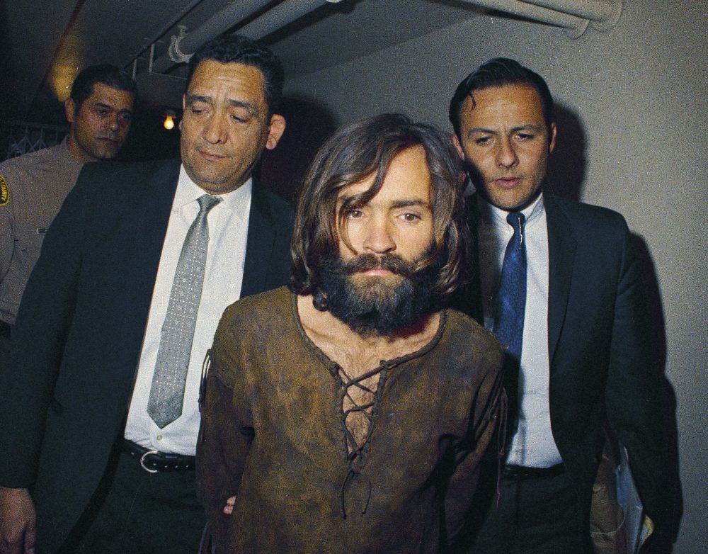 In this 1969 file photo, Charles Manson is escorted to his arraignment on conspiracy-murder charges in connection with the Sharon Tate murder case. Authorities say Manson, cult leader and mastermind behind 1969 deaths of actress Sharon Tate and several others, died on Sunday, Nov. 19, 2017. He was 83. (AP Photo, File)