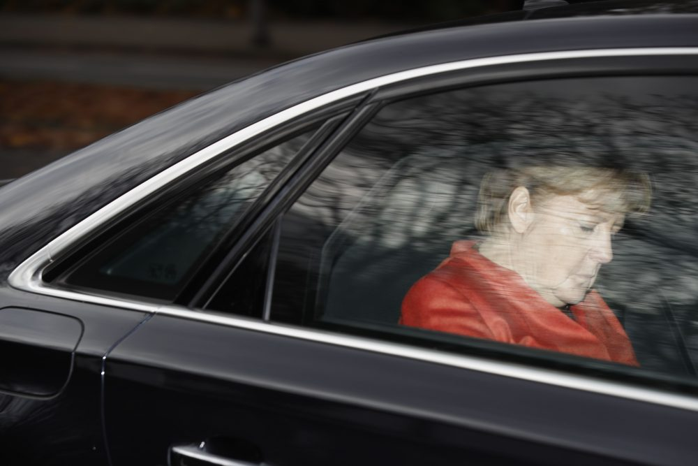 German Chancellor Angela Merkel leaves in her car from the presidential residence Bellevue Castle in Berlin, where she met the German president on Nov. 20, 2017 after coalition talks failed overnight. (Odd Andersen/AFP/Getty Images)