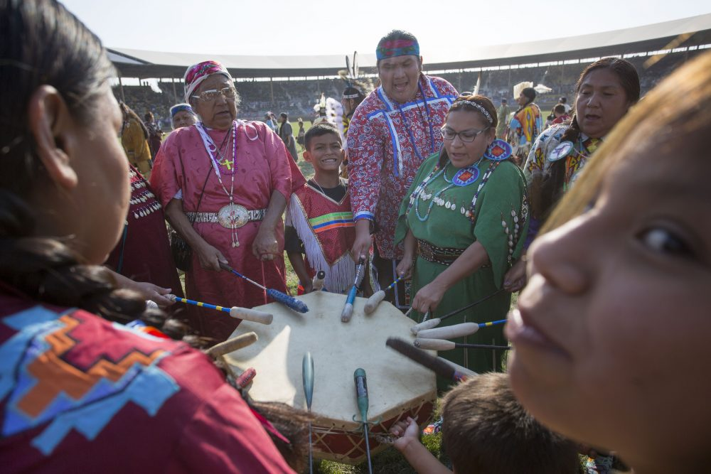 A group of drummers sing and beat a drum during a Native American dancing exhibition at the Pendleton Round-Up on Sept. 15, 2017 in Pendleton, Ore. The Pendleton Round-Up is a major annual rodeo featuring calf roping, bulldogging, bull riding, bronco riding and other events. (Natalie Behring/Getty Images)