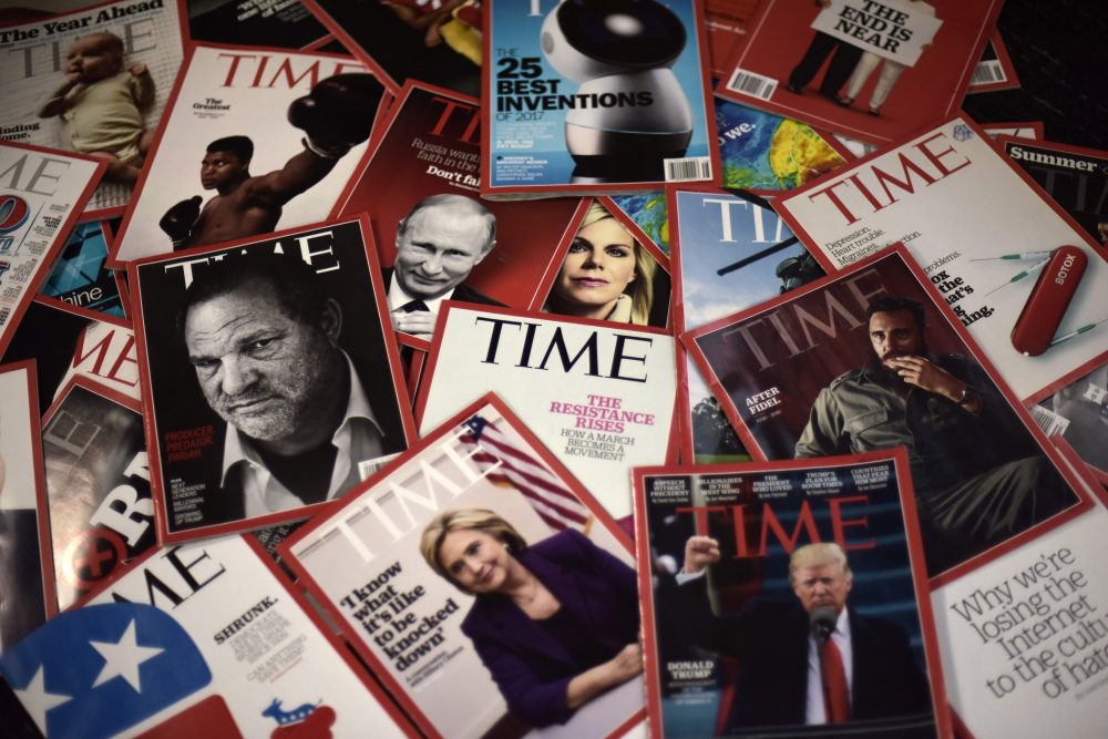 Time magazine copies are dispalyed on a table in Washgington on Nov. 27, 2017. Time Inc. is selling for $2.8 billion to media conglomerate Meredith Corporation, which is backed by the billionaire Koch brothers, who are known for supporting conservative causes. Time, which also publishes its eponymous magazine, Fortune and Sports Illustrated, began looking for a buyer late last year before giving up several months later, while welcoming options. (Eric Baradat/AFP/Getty Images)