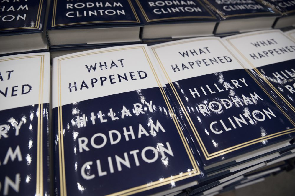 """A box of Hillary Clinton's book """"What Happened"""" are staged to be distributed outside the Warner Theatre in Washington, Monday, Sept. 18, 2017, as Clinton participates in a book tour event hosted by the Politics and Prose Bookstore. Clinton was in Boston Tuesday night on her book tour. (Carolyn Kaster/AP)"""
