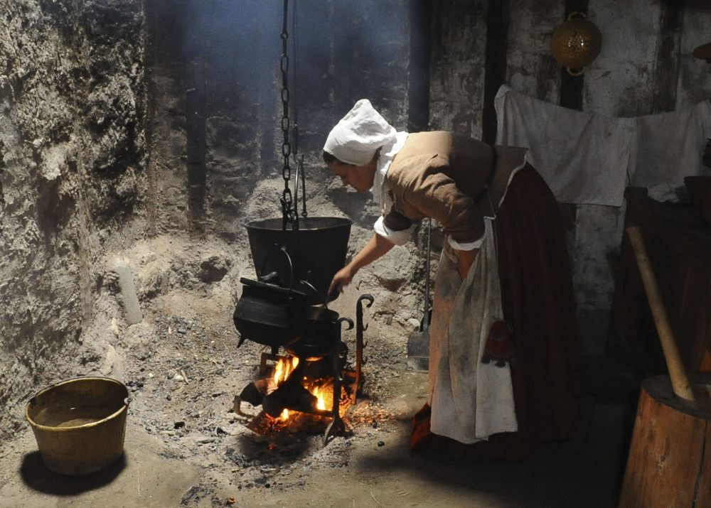 An employee of Plimoth Plantation cooks hasty pudding on Sept. 9, 2008, in Plymouth. (Lisa Poole/AP)