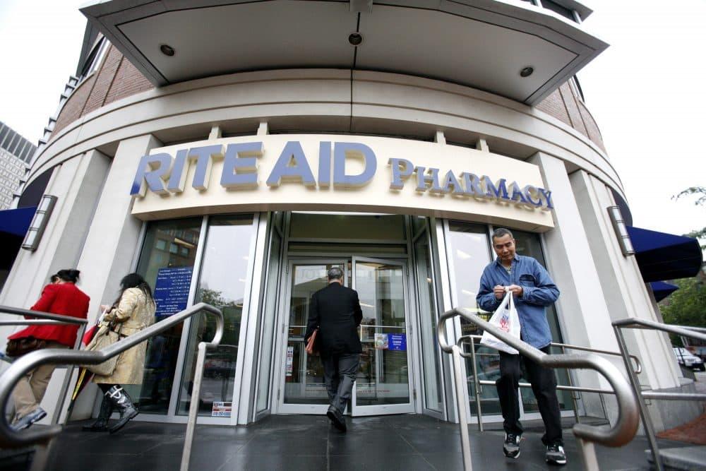 People walk outside a Rite Aid Pharmacy in Boston, Wednesday, June 24, 2009.  (Eric J. Shelton/AP)