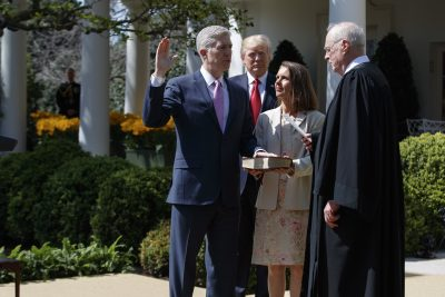 President Donald Trump watches as Supreme Court Justice Anthony Kennedy administers the judicial oath to Justice Neil Gorsuch, accompanied by his wife Marie Louise, during a public swearing-in ceremony in the Rose Garden of the White House in Washington, Monday, April 10, 2017. (Evan Vucci/AP)