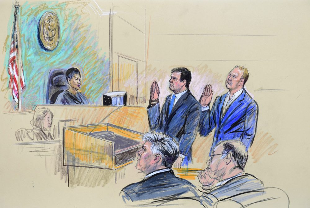 A court artist drawing shows President Donald Trump's former campaign chairman, Paul Manafort, center standing and Manafort's business associate, Rick Gates, in federal court in Washington, Monday, Oct. 30, 2017, before U.S. Magistrate Judge Deborah A. Robinson. (Dana Verkouteren/AP)