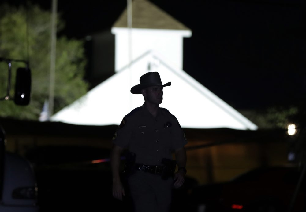 A law enforcement official walks past the First Baptist Church of Sutherland Springs, the scene of a mass shooting, Sunday, Nov. 5, 2017, in Sutherland Springs, Texas. (Eric Gay/AP)