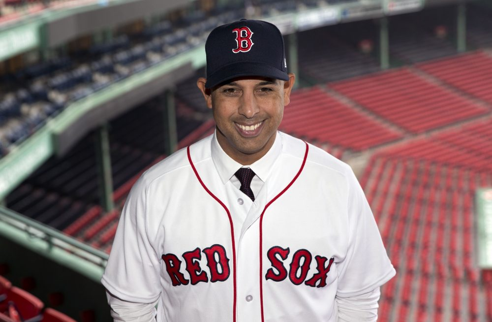 Boston Red Sox manager Alex Cora poses in Fenway Park following an introductory news conference. (Michael Dwyer/AP)