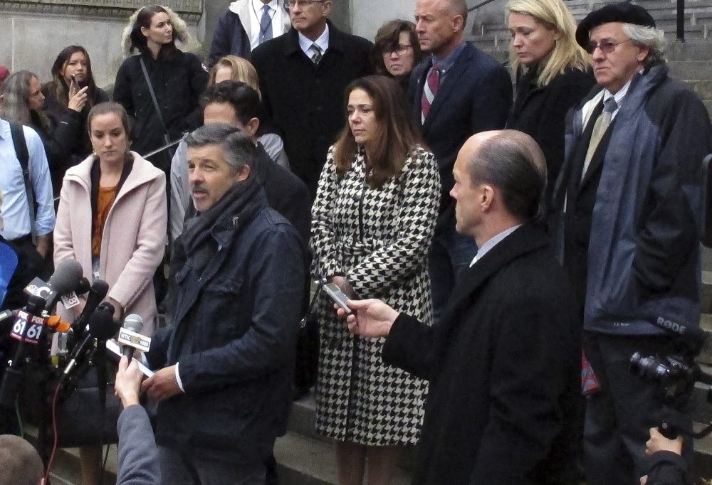 Ian Hockley, front left, father of Dylan Hockley, one of the children killed in the 2012 Sandy Hook Elementary School shooting, speaks outside the Connecticut Supreme Court Tuesday in Hartford, following an appeal hearing on whether gunmaker Remington Arms should be held liable for the massacre. (Dave Collins/AP)