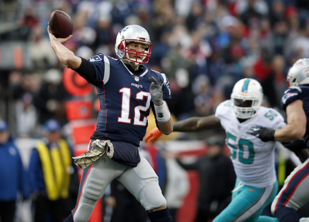 New England Patriots quarterback Tom Brady passes under pressure from Miami Dolphins defensive end Andre Branch (50) during the first half of an NFL football game, Sunday, Nov. 26, 2017, in Foxborough, Mass. (Michael Dwyer/AP)